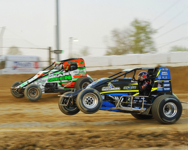 Dave Darland pulls the wheels up as he battles for position with Kevin Thomas, Jr.