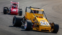 Kody Swanson (#20) leads Derek Bischak (#31) at Lucas Oil Raceway.