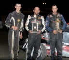 Adam Pierson is flanked by runnerup Josh Sunn and third-place  Robert Tucker after winning at Legion Speedway.