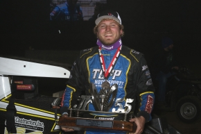 "Tyler Courtney poses in victory lane with the ""Junior Knepper 55"" trophy after winning Saturday night's USAC Midget Special Event at the Southern Illinois Center in Du Quoin."
