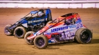 Brady Bacon (white) and C.J. Leary (black) battle for position Friday at Bubba Raceway Park.
