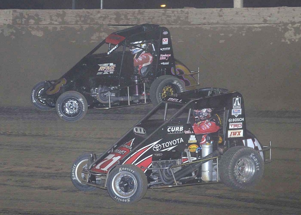 Darren Hagen (3) came out on top of a vicious battle with Chris Bell (71) to win Friday night's Honda National Dirt Midget Feature at Belle-Clair Speedway.