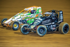 C.J. Leary (black #30) and Tyler Thomas (white #04) battle for position at Lawrenceburg (Ind.) Speedway in April 2017.