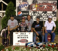 "Rico Abreu is joined by his Keith Kunz/Curb-Agajanian Motorsports team and Dan Thiel after winning the ""Sue Thiel Memorial"" at Angell Park Speedway."