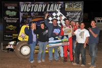 Dave Darland and crew celebrate after Sunday night's victory at Peoria, Ariz.