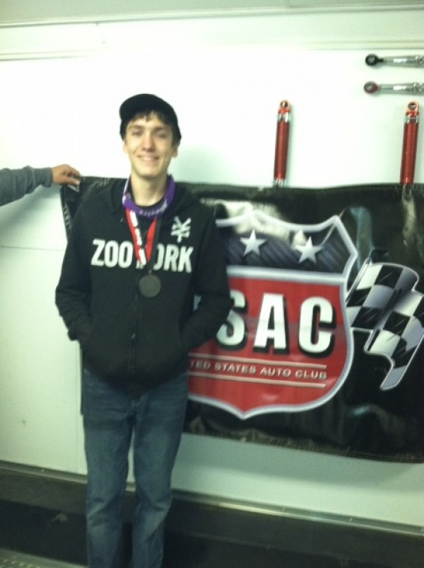 Chase Goetz poses after winning Saturday night's 15-lap Washington Honda Midget feature at Skagit.