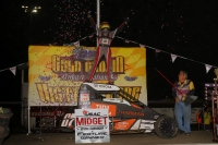 "Tanner Thorson celebrates his second straight sweep of the ""Gold Crown Midget Nationals"" after winning Saturday night's 40-lap finale at Tri-City Speedway."