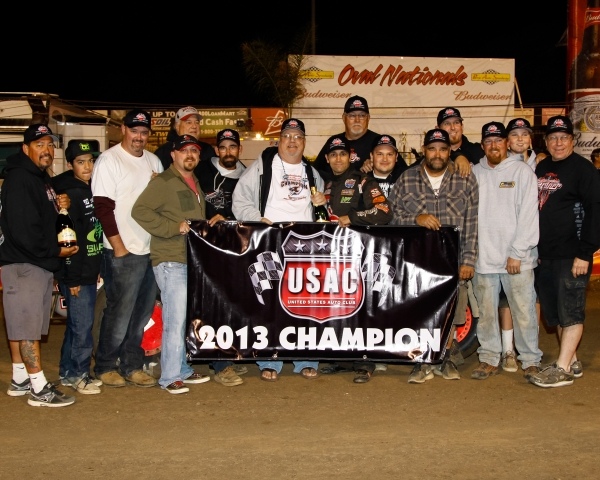 Damion Gardner celebrates with his team after claiming the 2013 AMSOIL USAC/CRA crown.