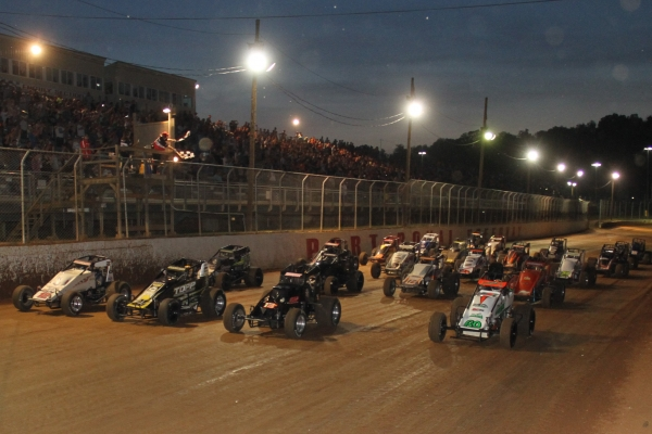 USAC AMSOIL National Sprint Cars give the traditional 4-wide salute to the fans at Port Royal (PA) Speedway during Eastern Storm in 2017.