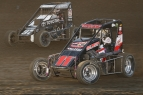 #11AG Dave Darland and #97 Spencer Bayston battle for position at Indiana's Kokomo Speedway during 2016 Indiana Midget Week.