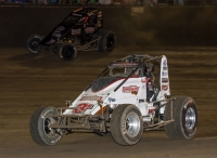 Kyle Cummins (3R) and Kevin Thomas, Jr. (4J) battle for position Saturday night at Kokomo Speedway during round 2 of Indiana Sprint Week