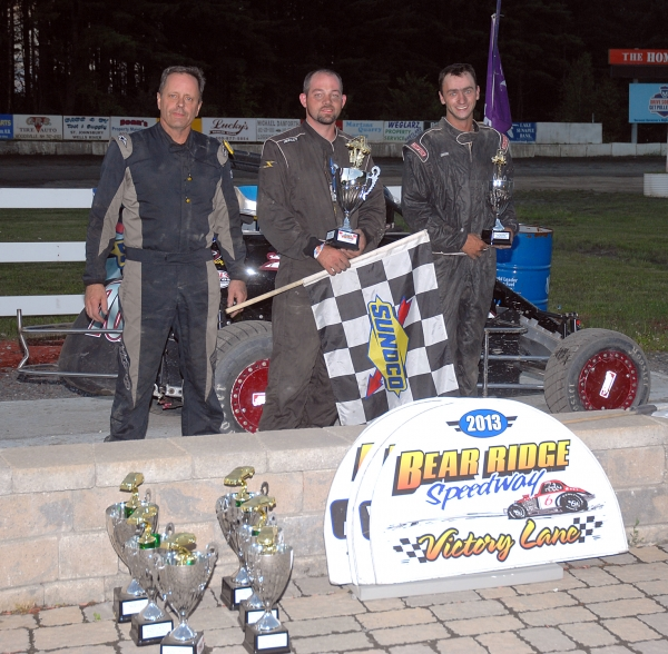 Winner Adam Pierson is flanked by Josh Sunn and Scott Viets after Saturday's DMA race at Bradford, Vt.