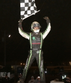 "Bryan Clauson takes the checkered flag at Abbottstown, Pennsylvania's Lincoln Speedway during ""Eastern Storm"" in June of 2016."