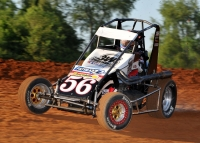 "Levi Jones, a former winner at Tri-City in the year-end ""Gold Crown Midget Nationals,"" was looking for his first ""Hut Hundred"" win aboard Shane Hmiel's #56..."