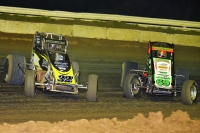 "#32 Chase Stockon and #69 Kevin Thomas, Jr. battle for the lead in the closing laps of Thursday's ""Winter Dirt Games"" feature at Bubba Raceway Park."