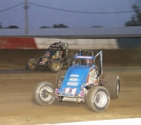 "Kevin Thomas, Jr. (#11) and eventual race winner Dave Darland (#71p) battle it out during the 2014 ""Tony Hulman Classic"""