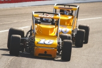 #16 Rex Norris III and #20 Jerry Coons, Jr. battle for position in a USAC Silver Crown Series event at Lucas Oil Raceway at Indianapolis in 2015.
