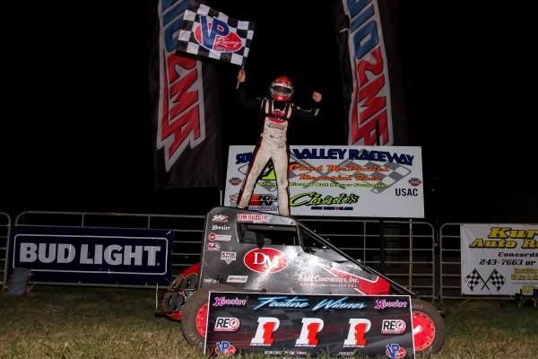 "Kevin Thomas, Jr. celebrates his second career ""Chad McDaniel Memorial"" win Wednesday night at Solomon Valley Raceway in Beloit, Kansas."