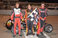 Win ner Jessica Bean is joined by runner-up Carson Hocevar and third-place Sam Hatfield in victory lane at Kalamazoo.