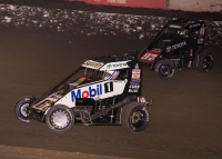 "#67 Logan Seavey battles #97K Rico Abreu for the lead on his way to victory during Saturday night's ""November Classic"" USAC P1 Insurance National & Light Up The World Western States Midget feature at Bakersfield (Calif.) Speedway."