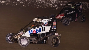 Logan Seavey (#67) and Rico Abreu battle for the win during the final laps of last year's November Classic USAC NOS Energy Drink National Midget feature at California's Bakersfield Speedway.