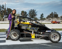 Toni Breidinger poses ater scoring her record-breaking 10th win at Madera Saturday.
