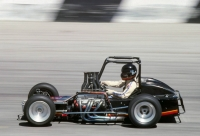 "Roy Cook, Jr., seen here in ""Winick's Weapon,"" a Chevy II-powered, Badger Midget owned by Jerry Winick, at the final race ever held at Speedway 605 in Irwindale, Calif. in September of 1978."