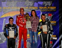"Christopher Bell tops the Midget podium at the ""Western World."" Brady Bacon was second and Bryan Clauson third."