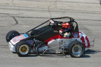 2006 USAC National Midget champion Jerry Coons, Jr. on the Salem (Ind.) Speedway High Banks.