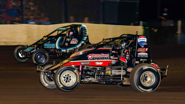 #3R Kyle Cummins battles #19AZ C.J. Leary for the lead en route to his victory in Saturday night's Haubstadt Hustler at Tri-State Speedway.