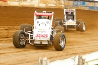 "Tyler Courtney #153 and Chris Windom #99 battle for position during the 2015 ""Sumar Classic."""