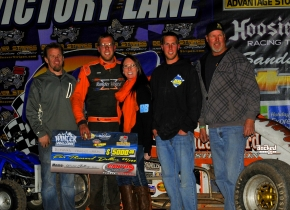 Richard Vander Weerd and crew celebrate after their win at Peoria Saturday.