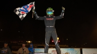 Gio Scelzi celebrates his first career USAC NOS Energy Drink National Midget feature victory Tuesday on night one of the Elk Grove Ford Hangtown 100 at California's Placerville Speedway.