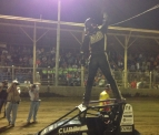 Bryan Clauson celebrates winning Saturday's Honda National Dirt Midget Feature at Belle-Clair Speedway.