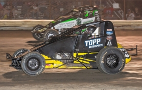 Indiana SprintWeek point leader Tyler Courtney (inside) battles Bryan Clauson (outside) for the lead at Gas City I-69 Speedway last Friday night.