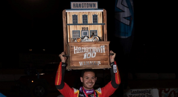 Kyle Larson holds the distinctive Elk Grove Ford Hangtown 100 trophy following his USAC NOS Energy Drink National and Western States Midget victory Wednesday at California's Placerville Speedway.