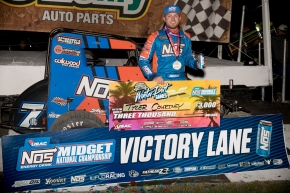 Tyler Courtney celebrates his victory in the USAC NOS Energy Drink National Midget opener Friday night at Bubba Raceway Park in Ocala, Florida.
