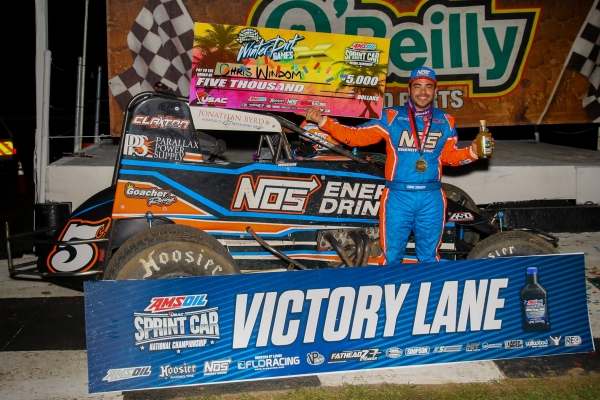 Chris Windom celebrates Thursday night's USAC AMSOIL National Sprint Car season-opening victory at Bubba Raceway Park.