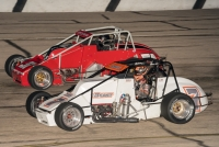 Kyle Robbins (in white) battles Derek Bischak at Wisconsin's Madison International Speedway.