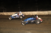 "Chris Windom races away from Bryan Clauson as he moved to the front of Saturday's AMSOIL National Sprint Car event during ""4-Crown Nationals"" at Eldora Speedway."