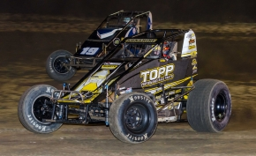 """Smackdown"" Night 2 winner Tyler Courtney (#23c) passes Hunter Schuerenberg for the lead Friday night at Kokomo Speedway."