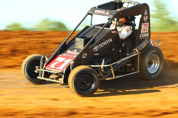 "BELL REBOUNDS FROM THURSDAY FLIP, WINS BLOOMINGTON ""MIDGET WEEK"""