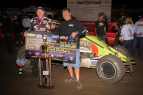 "Dave Darland (left) and car owner Jeff Walker celebrate in victory lane after winning Friday's night #2 of the ""Oval Nationals"" at Perris (Calif.) Auto Speedway."