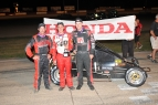 Kyle Hamilton, Bobby Santos and Dalton Armstrong share the podium at Grundy County.