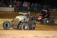 RJ Johnson (77) takes the lead from longtime feature race leader Mike Martin (16) at Tucson's beautiful USA Raceway during Saturday's USAC Southwest Sprint Car event.