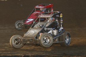 Brady Bacon (#76m) and Gage Walker battle for position in 2016 USAC National Midget action at Kokomo.