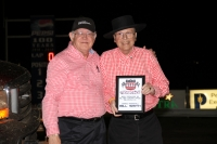 Bill Smith accepts the Grand Marshal's plaque Thursday at Belleville, Kans.