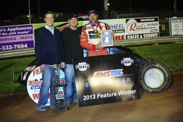 "Dave Darland is joined in victory lane by Zach & Robbie Rice after winning Friday night's ""Larry Rice Classic"" at Bloomington Speedway."