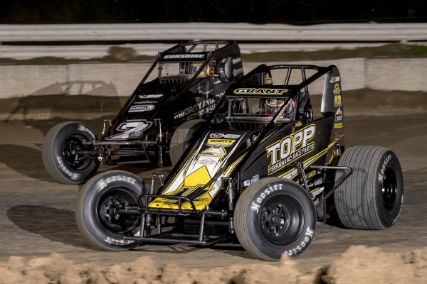 #4 Justin Grant battles for position alongside Tyler Courtney at Bubba Raceway Park in February.
