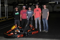 Team Captain Kevin Thomas is surrounded by team members after their Tuesday night USAC Go-Kart enduro in Speedway, IN